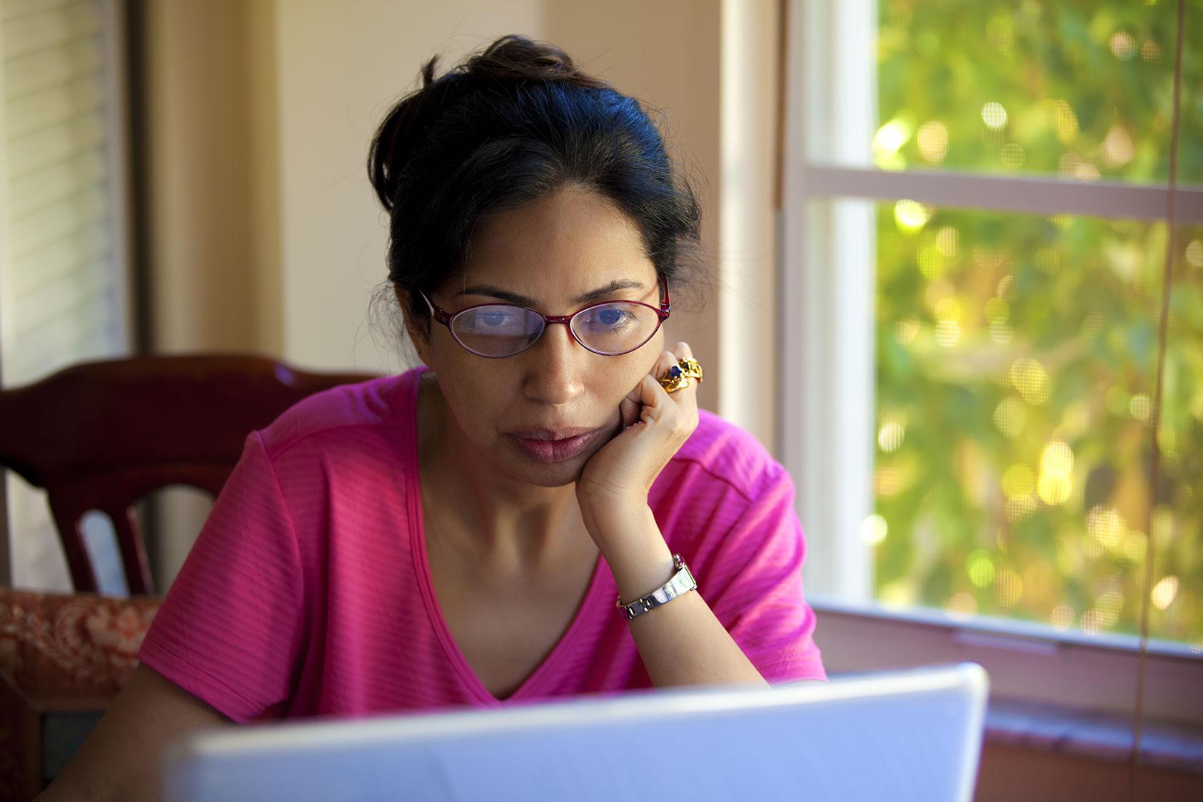 Woman reading about neurofeedback